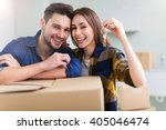 couple showing keys to new home  | Shutterstock . vector #405046474