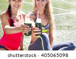 two happy women drinking... | Shutterstock . vector #405065098