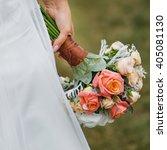 bride holding wedding bouquet... | Shutterstock . vector #405081130