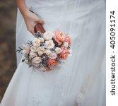 bride holding wedding bouquet... | Shutterstock . vector #405091174