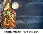 served sliced catfish fillets... | Shutterstock . vector #405141154