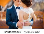 bride and groom walking on the... | Shutterstock . vector #405189130