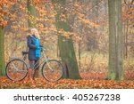happy active woman riding bike... | Shutterstock . vector #405267238