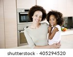 mother holding young daughter... | Shutterstock . vector #405294520