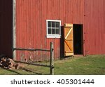 Side Of A Red Barn On A Farm I...