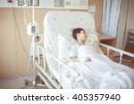 Small photo of Abstract blurred background of illness asian child admitted at modern and comfortable equipped hospital room with infusion pump intravenous IV drip. Health care and people concept. Vintage style.