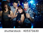 Stock photo young friends dancing energetically in nightclub 405373630