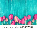 frame of tulips on turquoise... | Shutterstock . vector #405387334