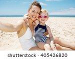 family fun on white sand....   Shutterstock . vector #405426820