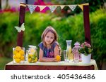girl stand at the lemonade stand | Shutterstock . vector #405436486