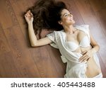 woman in lingerie laying on the ...   Shutterstock . vector #405443488
