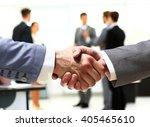 close up of businessmen shaking ... | Shutterstock . vector #405465610