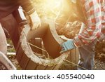 two craftsmen taking together a ... | Shutterstock . vector #405540040