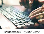 man's hands typing on laptop... | Shutterstock . vector #405542290