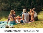 young people having picnic near ... | Shutterstock . vector #405610870