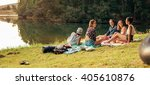 young friends having picnic... | Shutterstock . vector #405610876