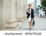 Businesswoman Walking On Street