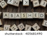 Small photo of the word of ABASHED on building blocks concept