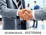 handshake in front of business... | Shutterstock . vector #405700846