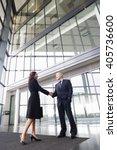 a businessman greeting a female ... | Shutterstock . vector #405736600