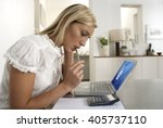 young woman working from home | Shutterstock . vector #405737110