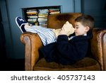 little boy lying in armchair... | Shutterstock . vector #405737143