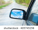 car mirror with blue sky above... | Shutterstock . vector #405745258