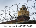 guarding tower behind barbed... | Shutterstock . vector #405790648