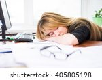 tired woman at the computer in... | Shutterstock . vector #405805198