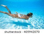 Woman Swimming Underwater In A...