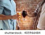 two men clinking glasses of... | Shutterstock . vector #405966484