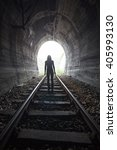 man silhouetted in a tunnel... | Shutterstock . vector #405993130