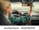woman in car look in rear view... | Shutterstock . vector #406058554