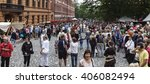 Small photo of TURKU, ABO FINLAND ON JUNE 29. View of spectator, viewer, audience in a square on June 29, 2013 in Turku, Abo Finland. Unidentified people in the Medieval Festival. Stand along the walls.