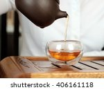 young woman pouring black tea... | Shutterstock . vector #406161118
