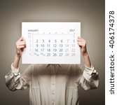 woman is holding january...   Shutterstock . vector #406174378