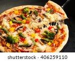 vegetarian pizza on a dark... | Shutterstock . vector #406259110