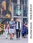 Small photo of BEIJING-OCTOBER 19, 2014. Young men in sportswear at shopping area. The Chinese recently surpassed the Americans as the biggest consumers of luxury goods and have picked up the mantle of logo-mania.