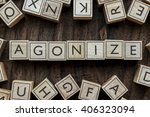 Small photo of the word of AGONIZE on building blocks concept
