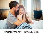 happy couple in bed showing...   Shutterstock . vector #406332946