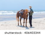Small photo of A horse and stableman on the beach
