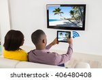 happy couple sitting on sofa... | Shutterstock . vector #406480408