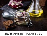 Stock photo marinated herring in a jar with onion and herbs 406486786