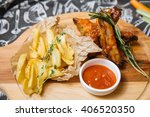 fried ribs with new potatoes | Shutterstock . vector #406520350