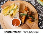 fried ribs with new potatoes | Shutterstock . vector #406520353