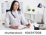 doctor with stethoscope sitting ... | Shutterstock . vector #406547008