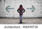 young girl in front of a wall... | Shutterstock . vector #406590718