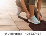 female athlete tying laces for... | Shutterstock . vector #406627414
