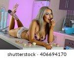 sexy blonde girl in kitchen | Shutterstock . vector #406694170