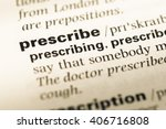 Small photo of Close up of old English dictionary page with word prescribe